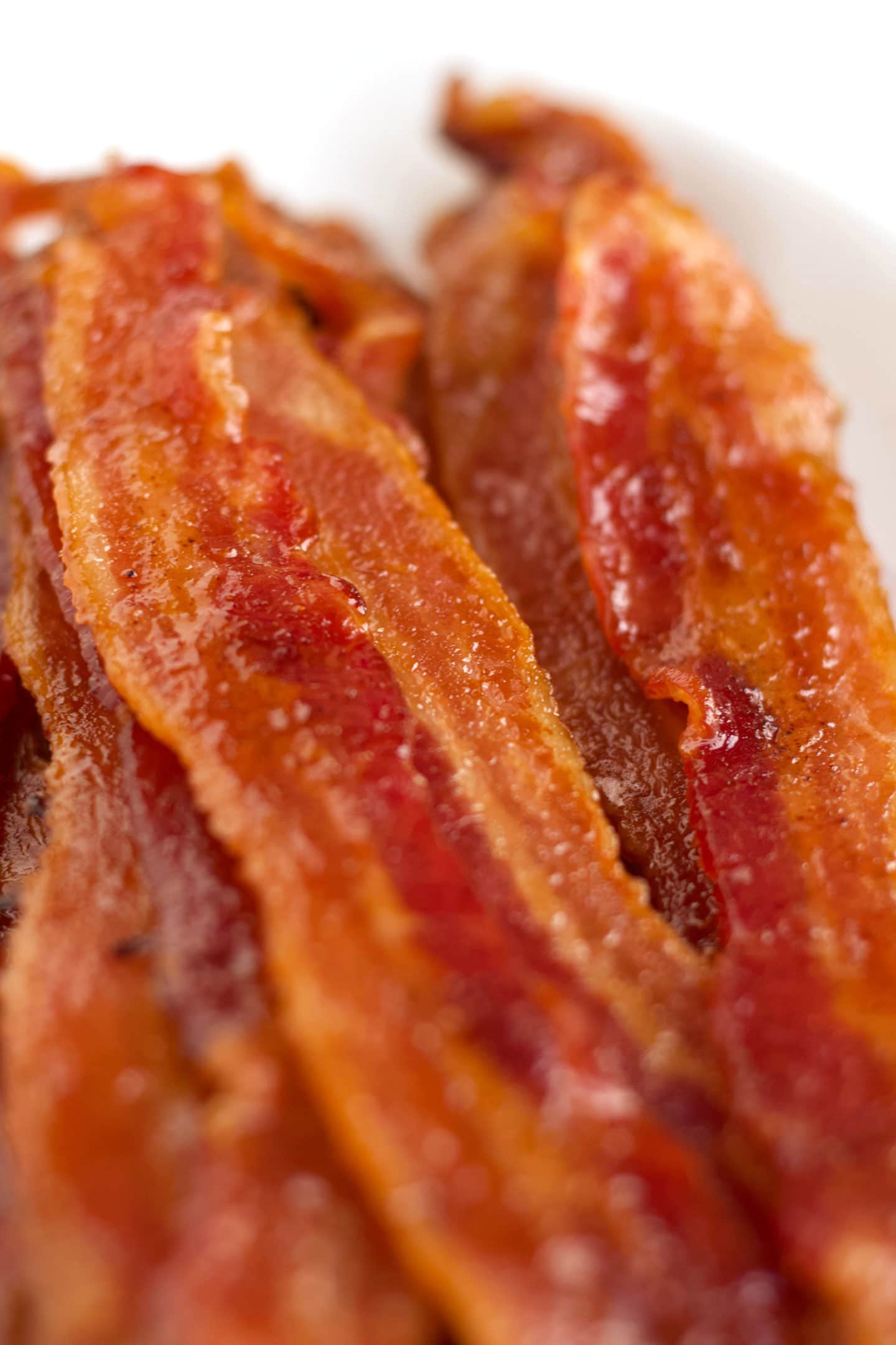 Close-up of stacked bacon on plate.