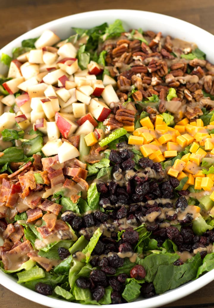 Full Autumn Chopped Salad with dressing drizzled across.