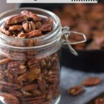 Jar of maple pecans with cast iron and text overlay