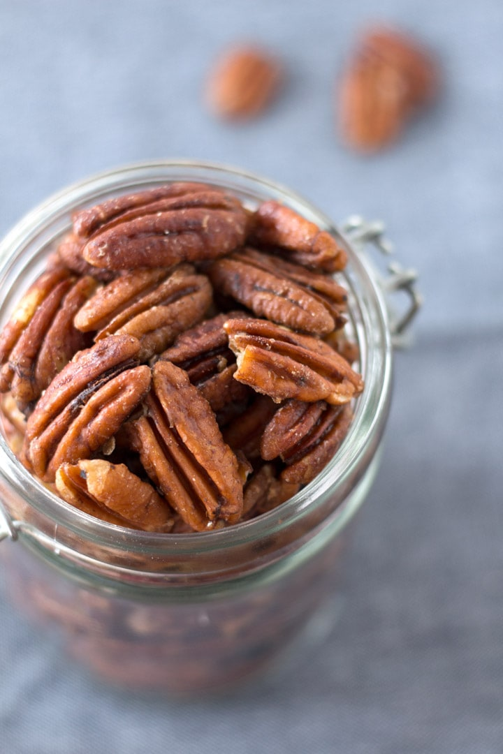 Close up of mapled pecans in a jar