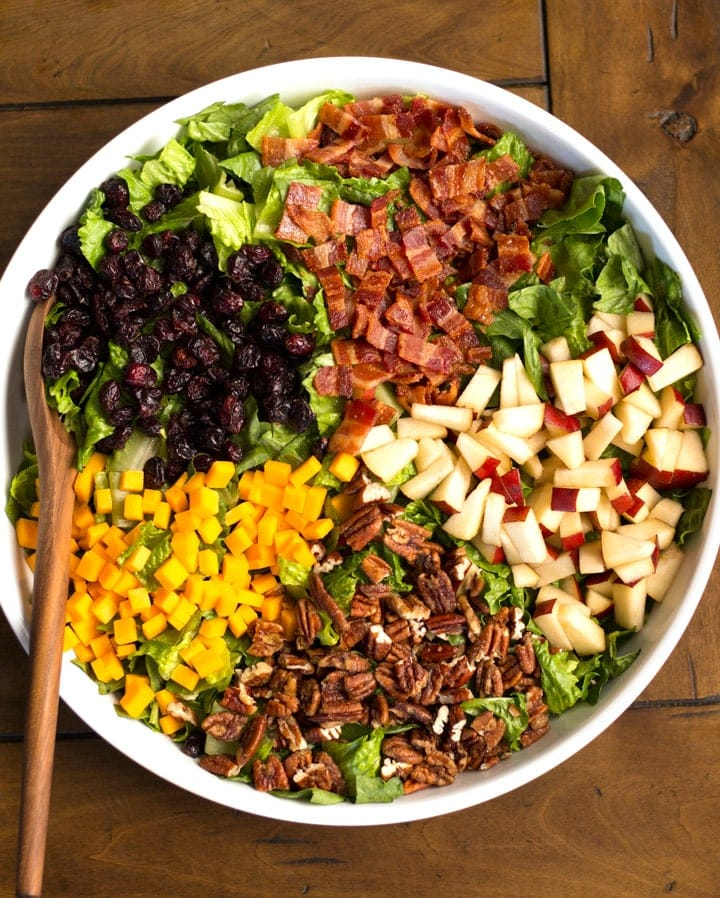 Autumn Chopped Salad with pears, pecans, cheese, cranberries, and bacon.