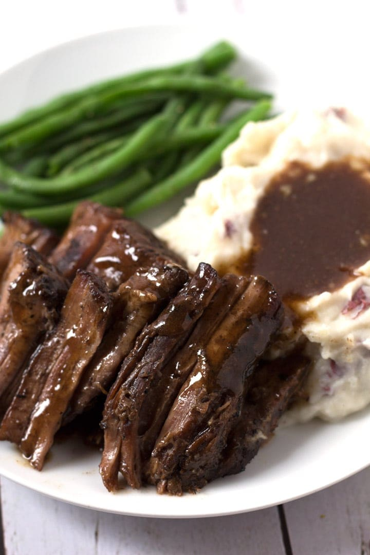 Pot Roast On Plate with Mashed Potatoes and Green Beans