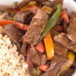 Close up of pepper steak and rice in bowl