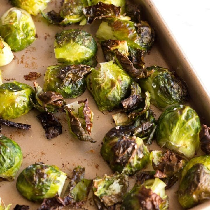 Corner of sheet pan with Crispy Roasted Brussels Sprouts