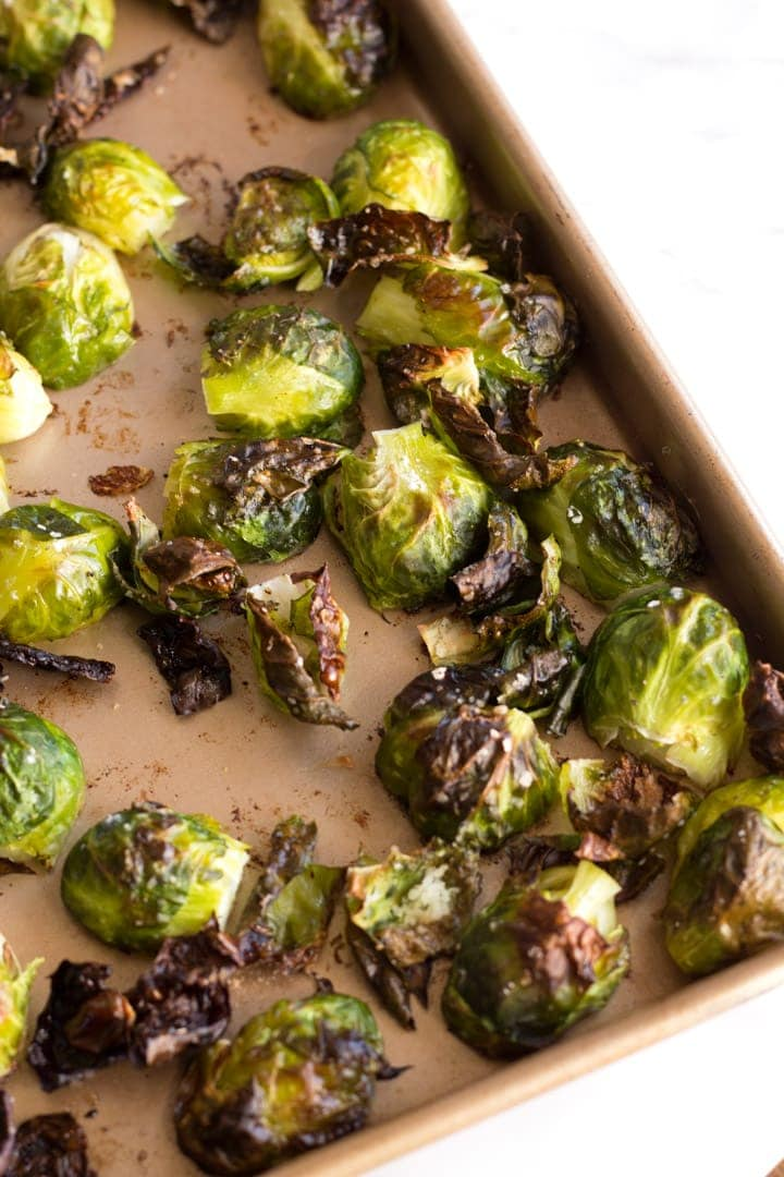 Corner of Sheet Pan with roasted Brussel sprouts.