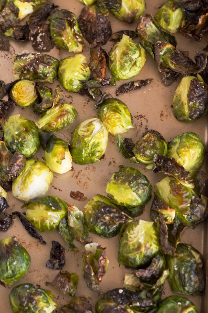 Overhead of crispy roasted Brussels sprouts on sheet pan.