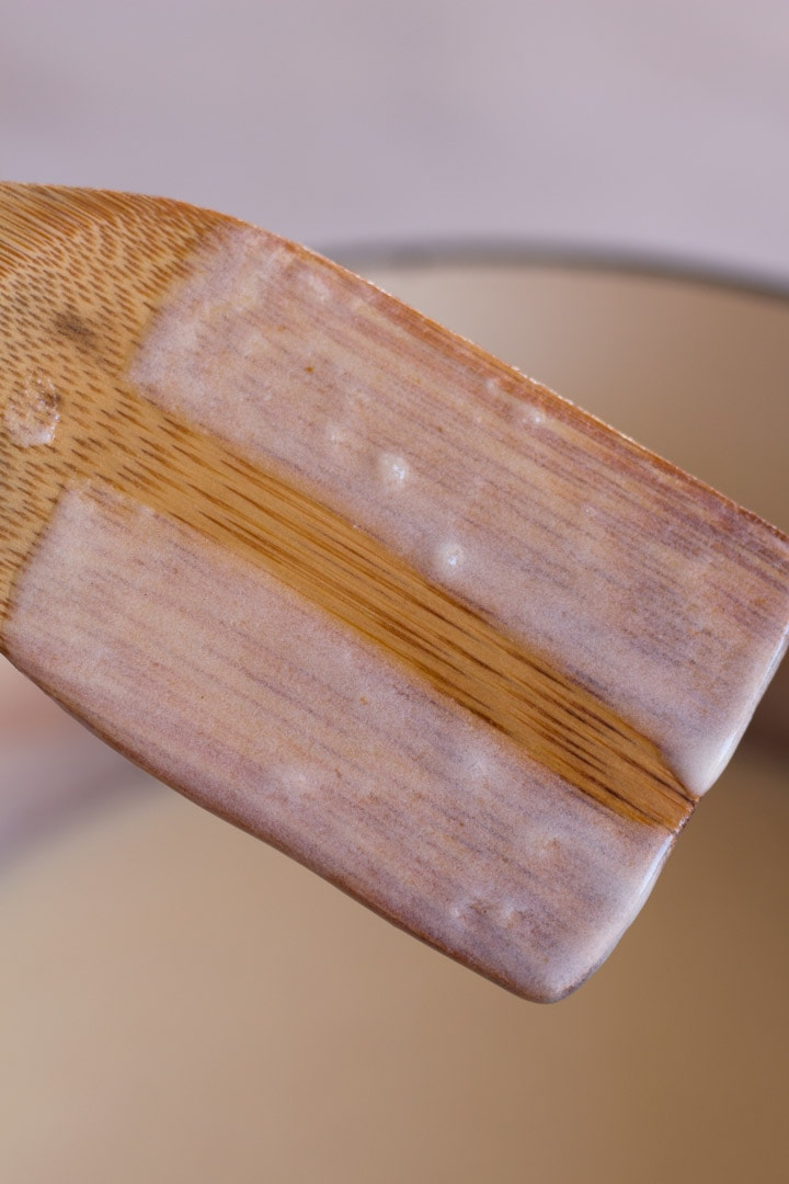 Sauce on back of spoon with line drawn through to test thickness.