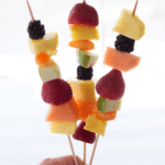 Fruit kebobs with text overlay