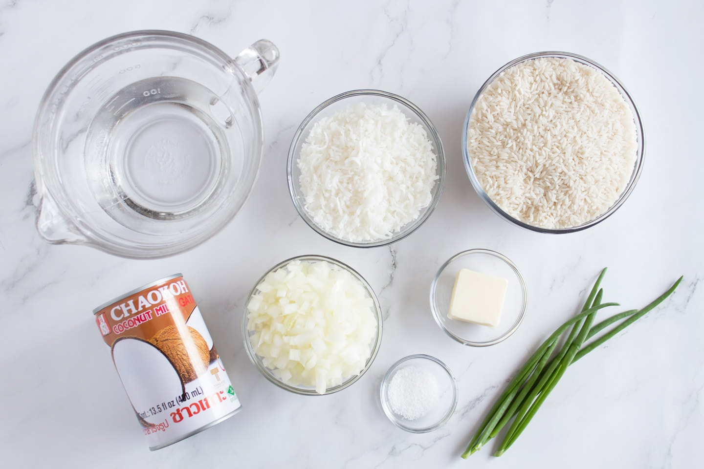 Ingredients for rice on white counter