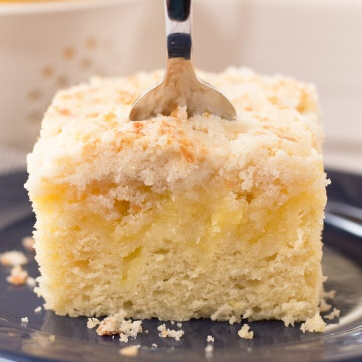 Piece of lemon coffee cake with fork in it
