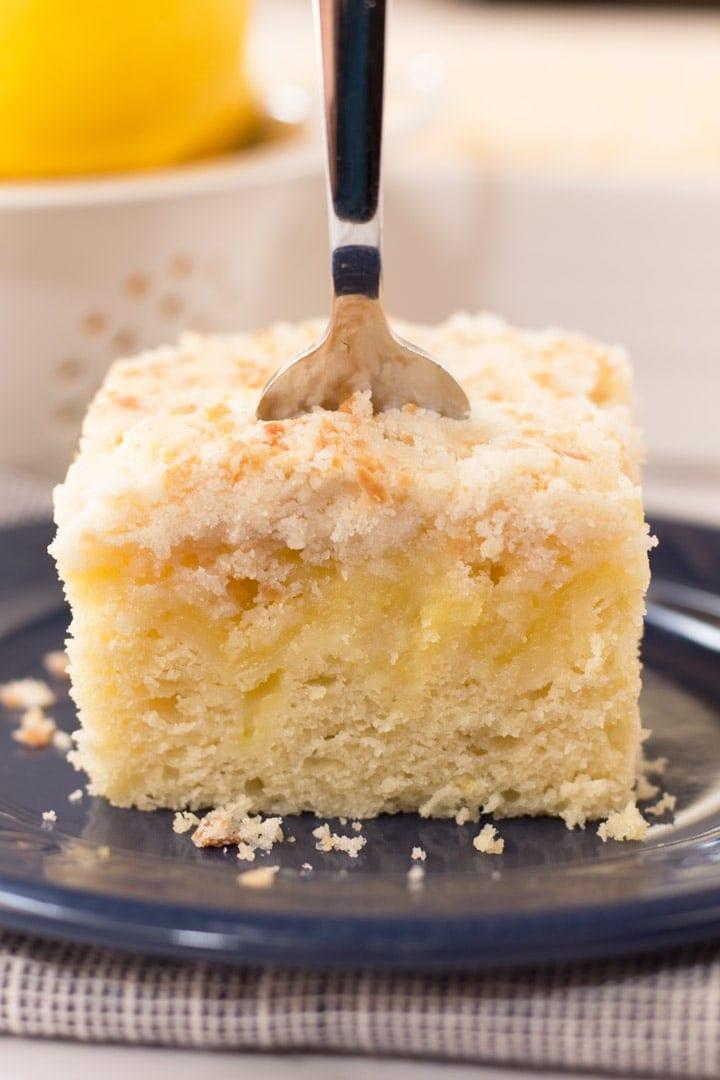 Up close Lemon Coffee Cake with fork.