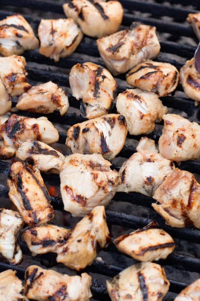Chunks of marinated chicken on the grill.