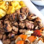Platter of chicken kabobs with text overlay