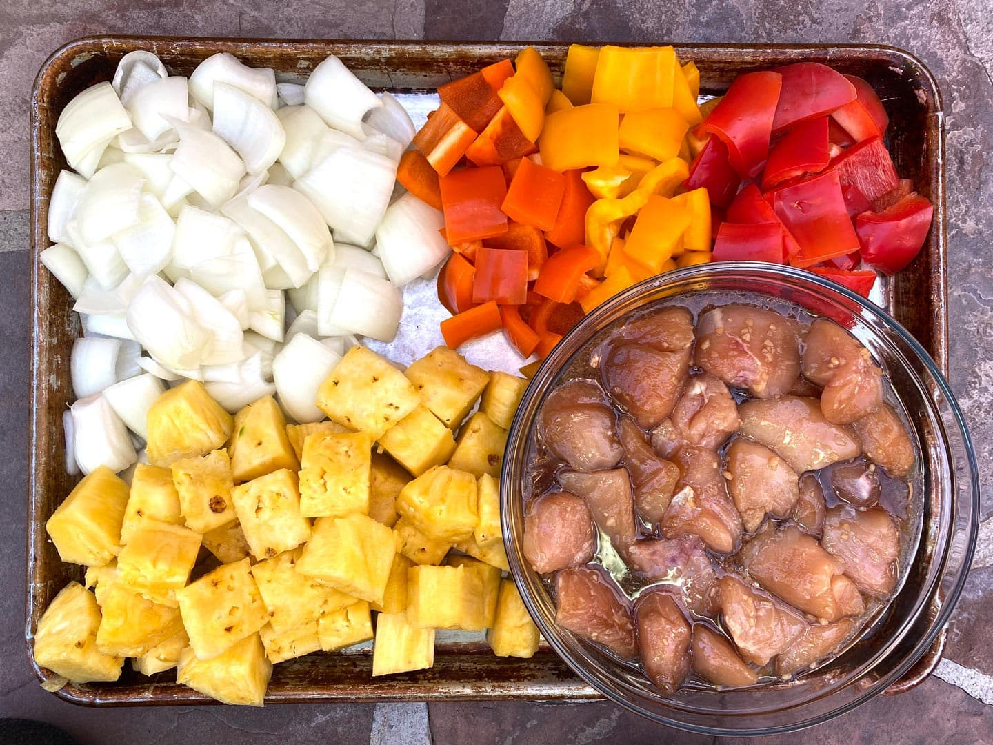 Ingredients for grilled Honey Chicken Kabobs on sheet pan.