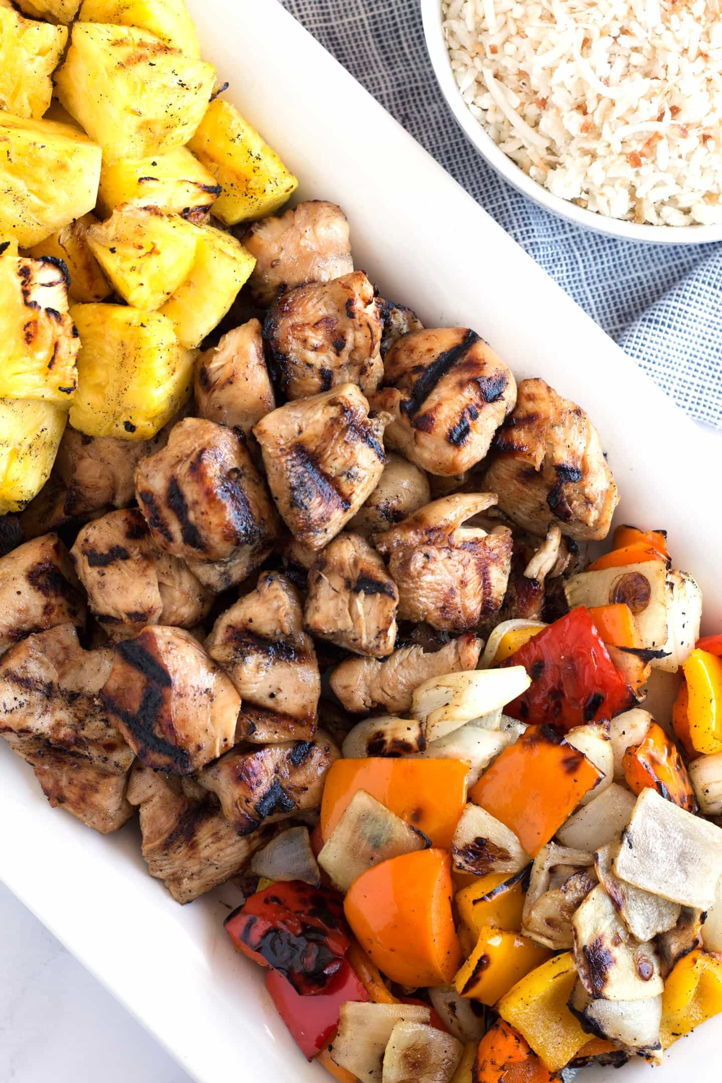 Overhead view of platter of grilled Honey Chicken Kabobs.