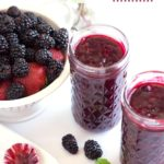 Jars of Triple Berry Sauce with text overlay