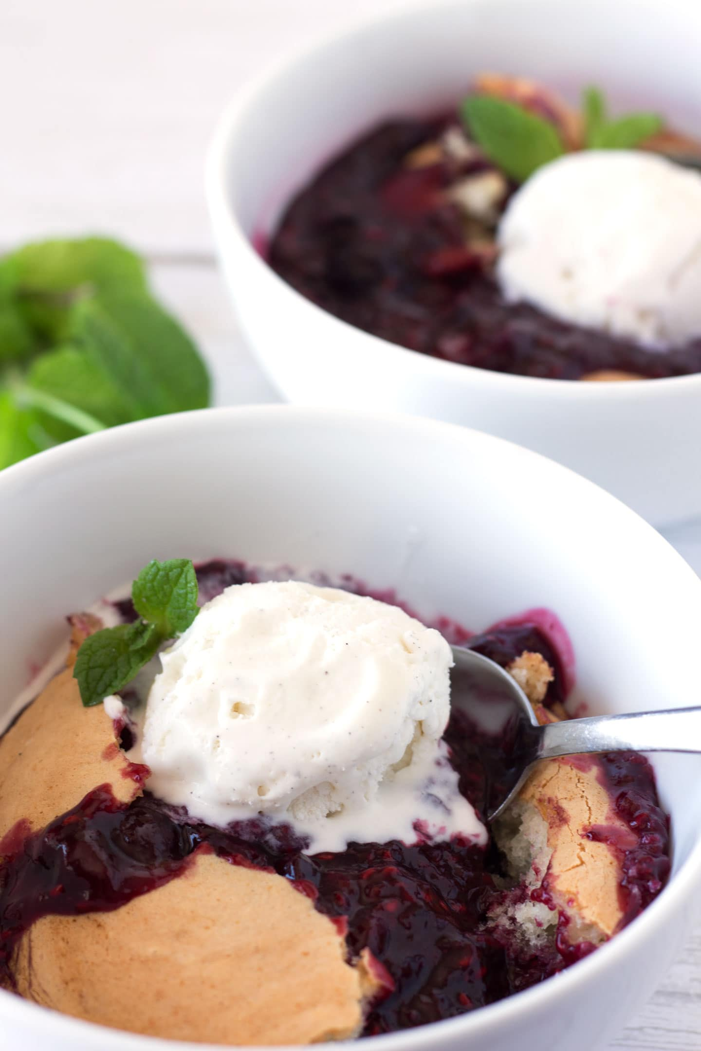Two bowls of berry cobbler
