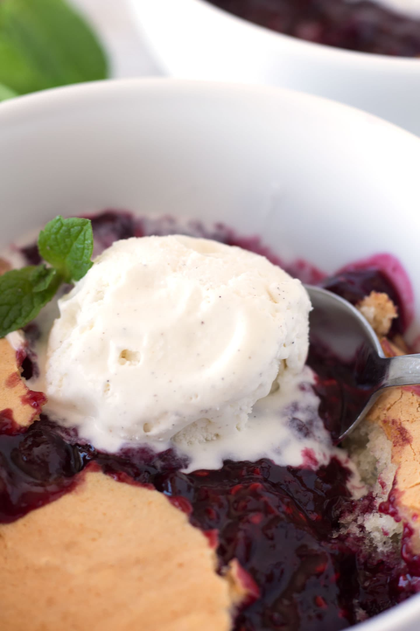 Berry Cobbler and ice cream in bowl