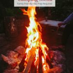 Fire and picnic table in camping site with text overlay