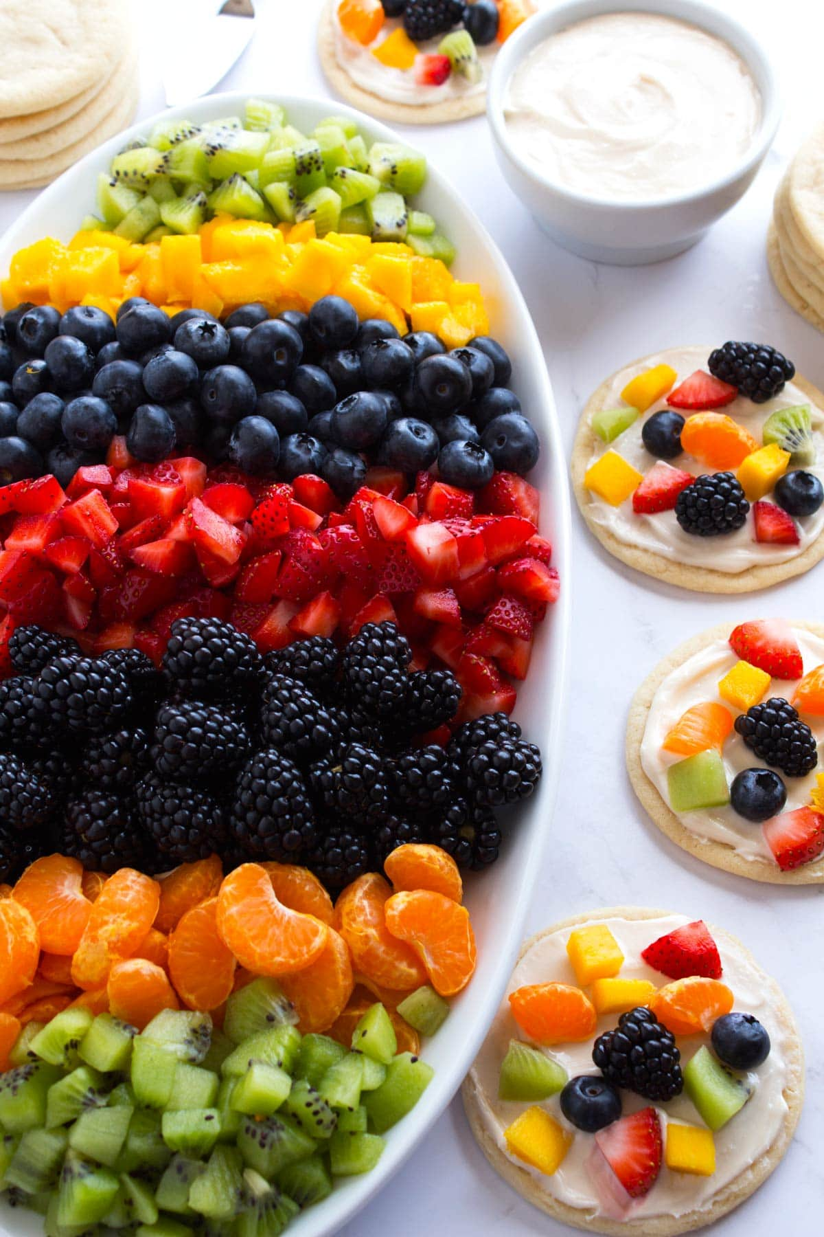Fruit platter and mini fruit pizzas.