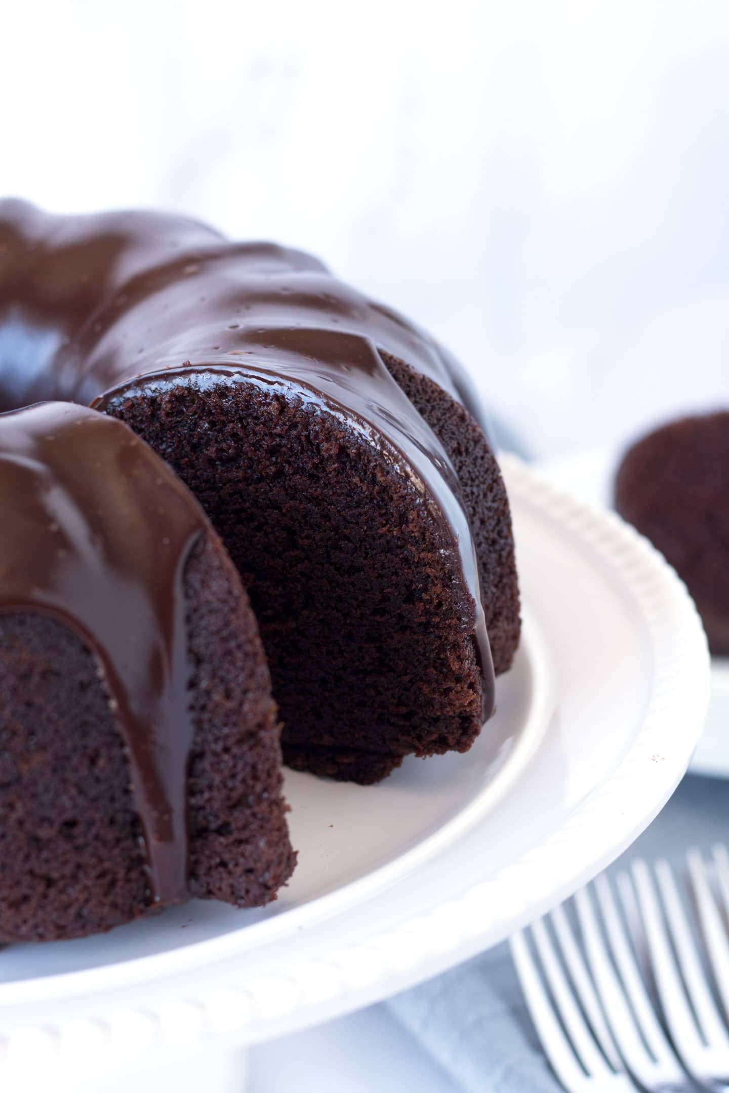 Chocolate bundt cake with slice cut out