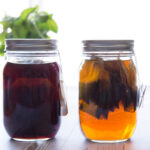 Two jars of concentrate side by side.