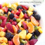 Bowl of fruit salad with text overlay