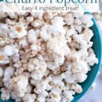 Teal bowl of White Chocolate Churro Popcorn with text overlay