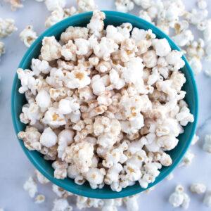 white chocolate churro popcorn in blue bowl