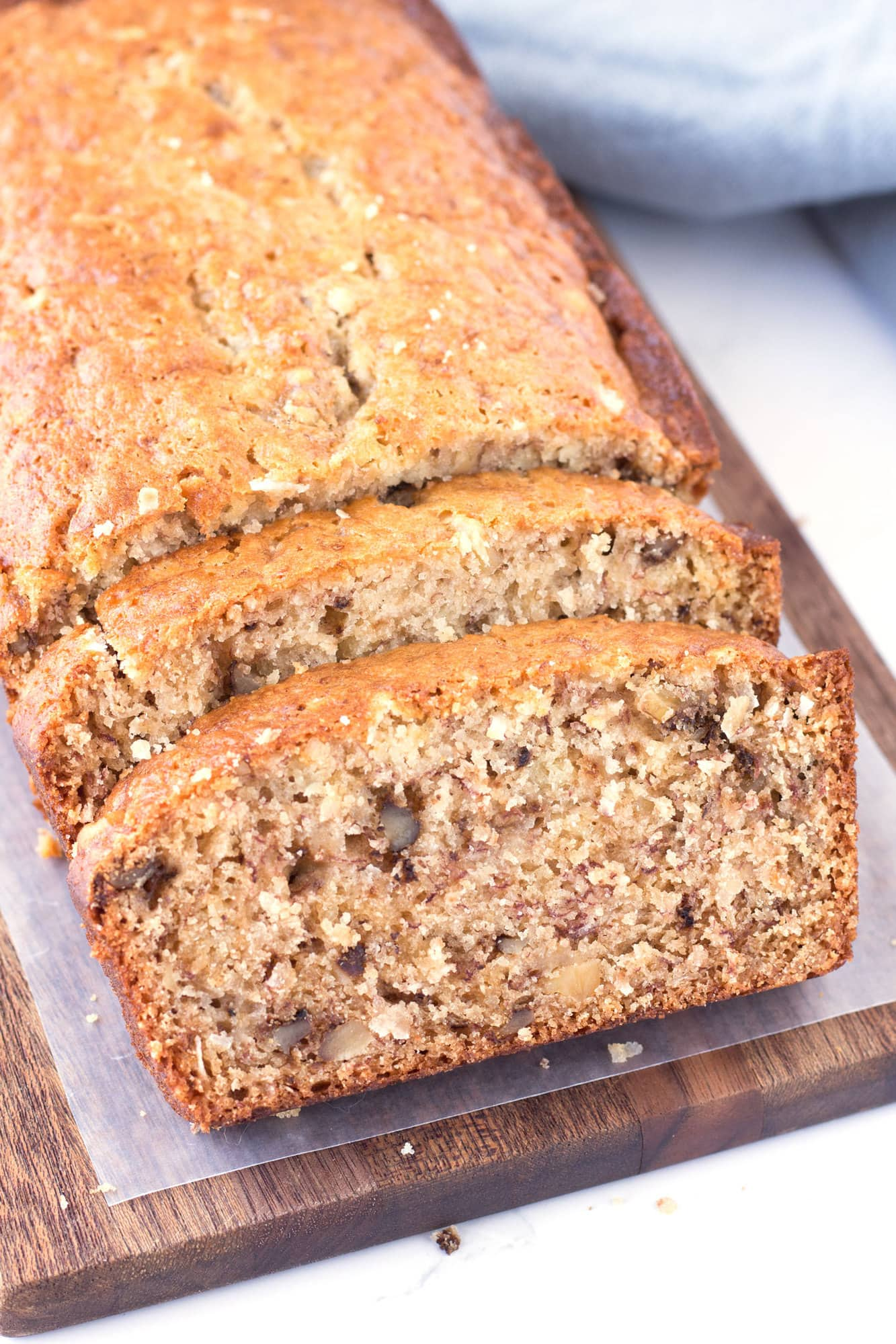 Slices of Easy and Moist Banana Bread on cutting board