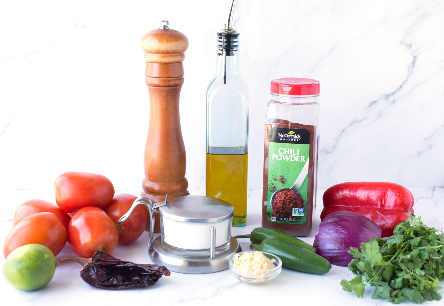 Ingredients for cooked red salsa on counter