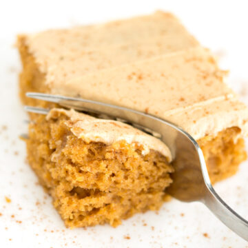 Fork cutting into piece of pumpkin sheet cake