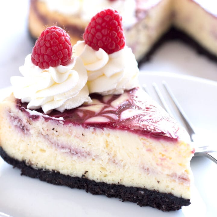 Slice of White Chocolate Raspberry Cheesecake with fork.