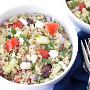 Greek Quinoa Salad with forks and napkins