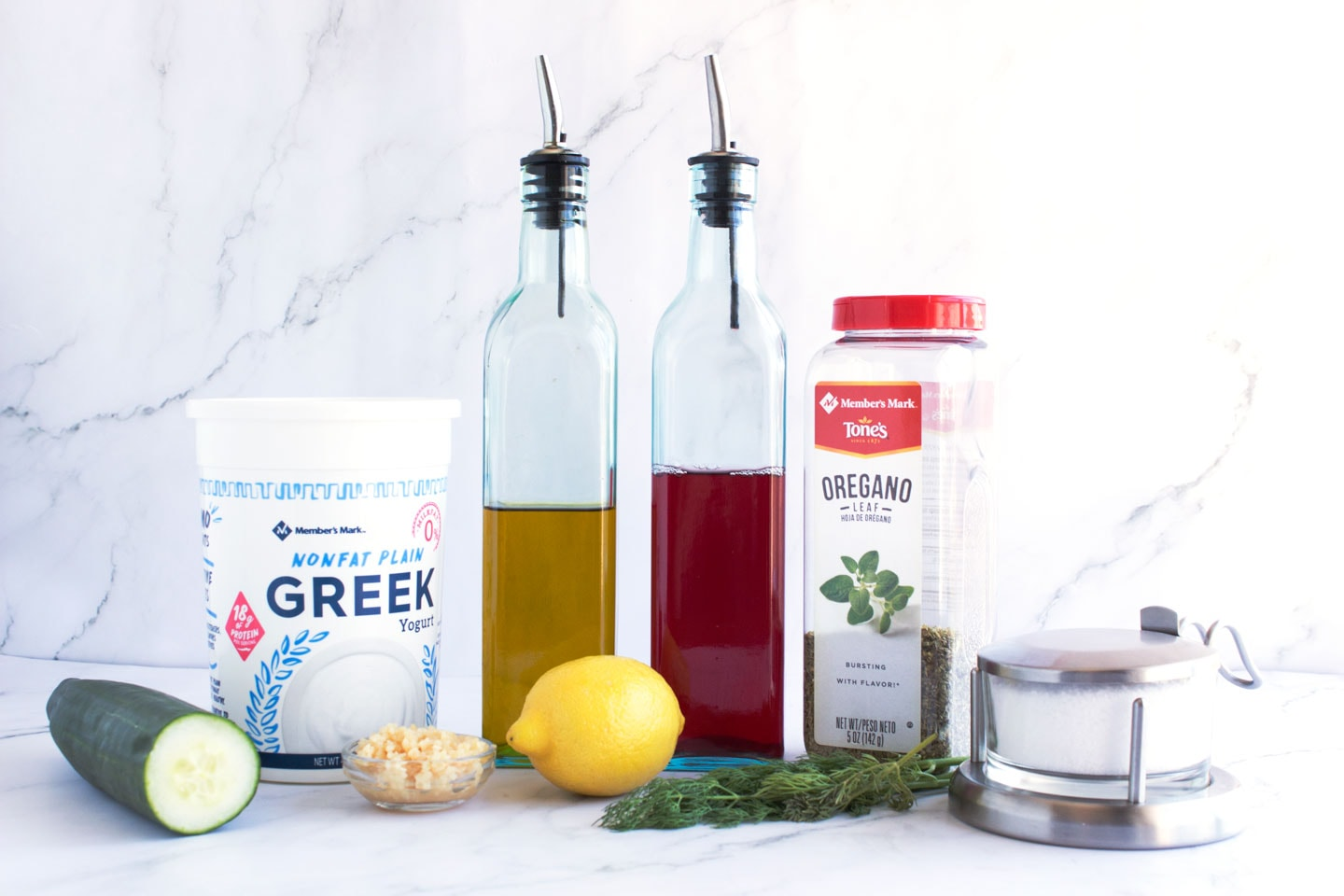 Ingredients in tzatziki lined up on the counter.