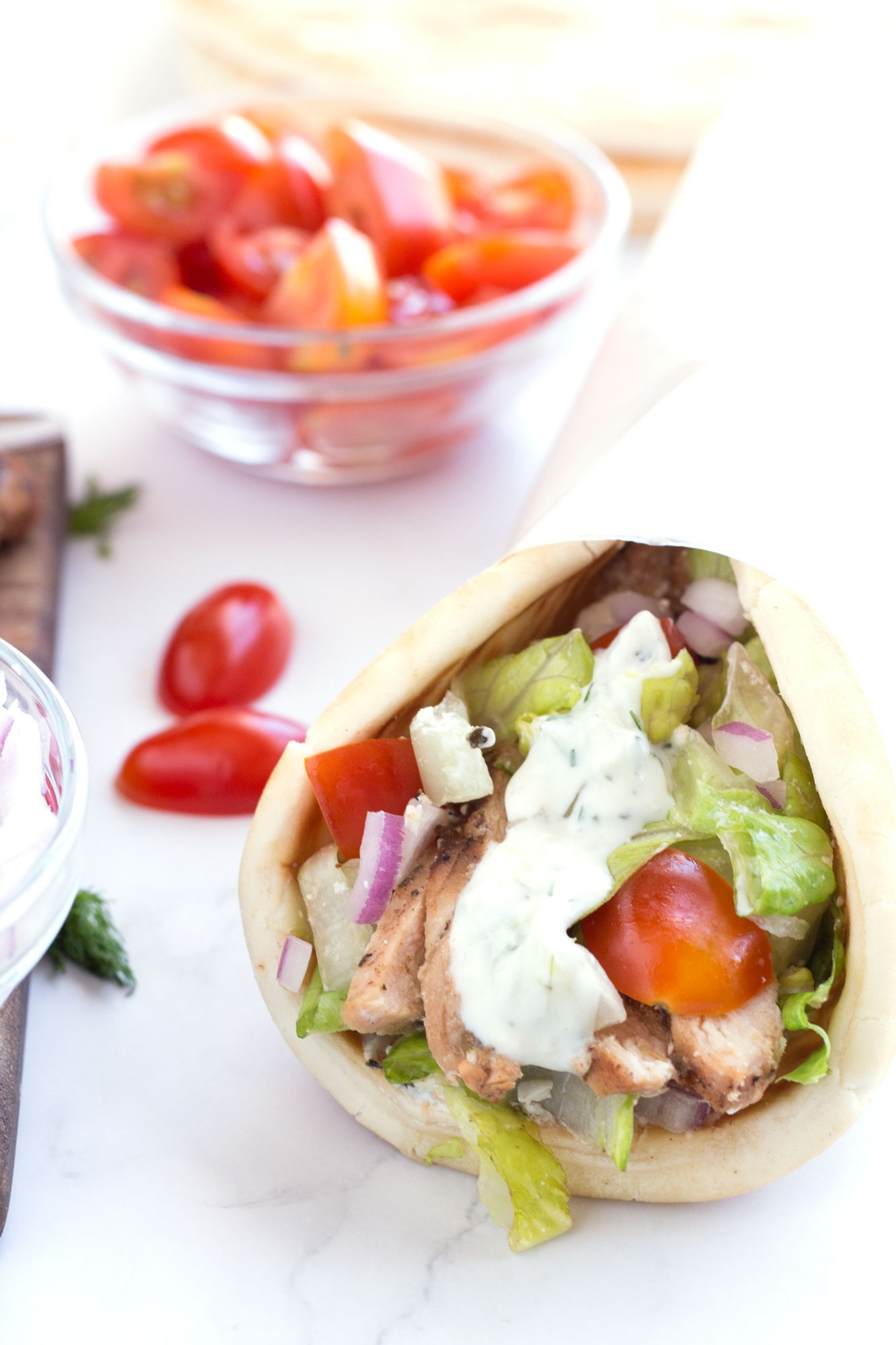 Grilled chicken wrapped in pita with tomatoes, lettuce and tzatziki.