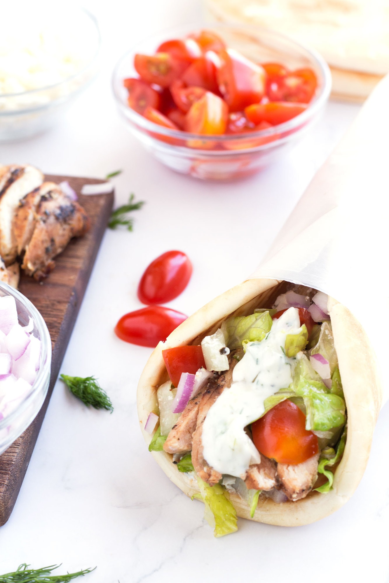 Grilled Greek Chicken Gyro with toppings on the counter