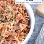 Bowl of Chicken Piccata Pasta with parmesan cheese with text overlay