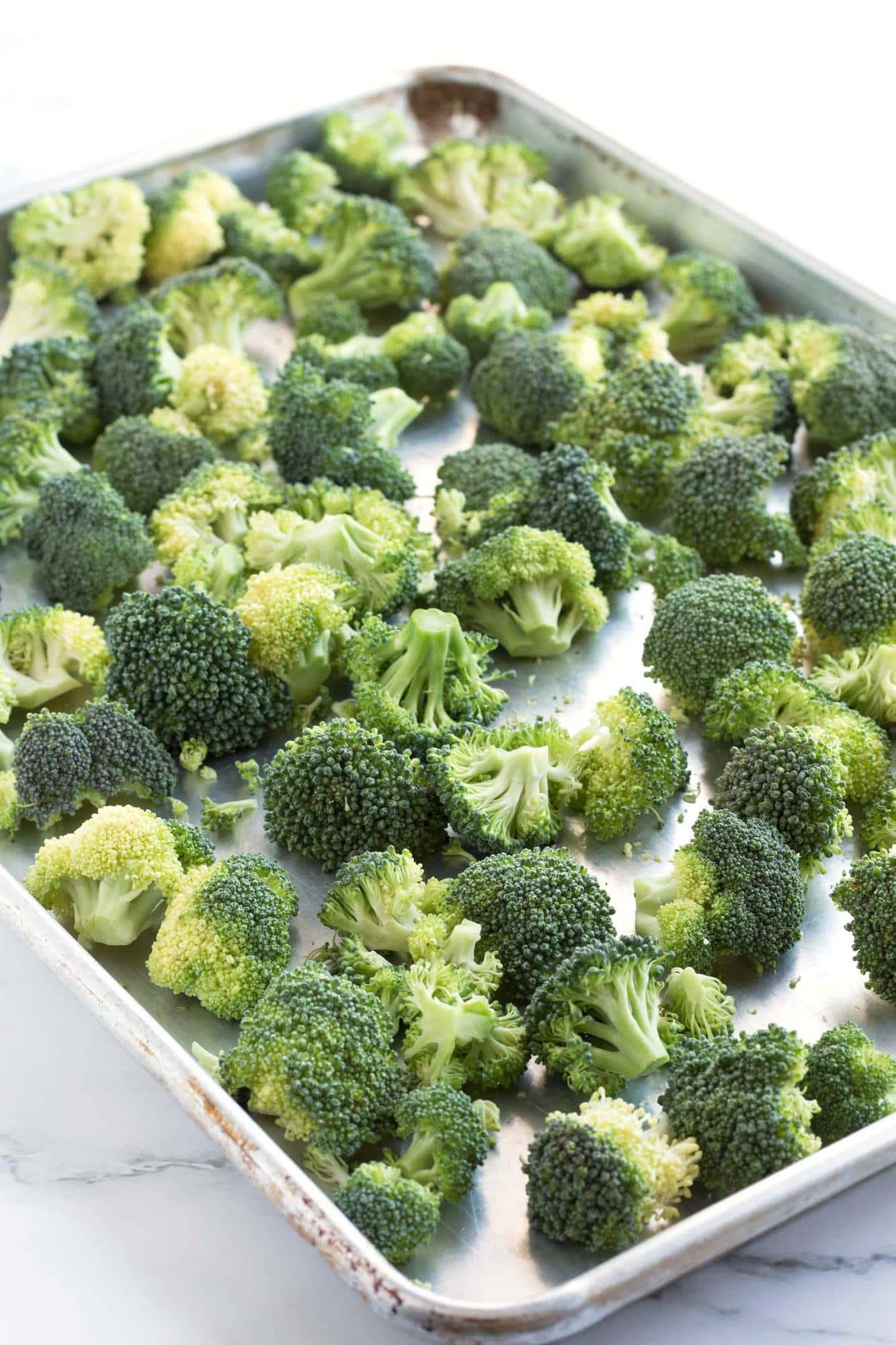 Raw broccoli on sheet pan