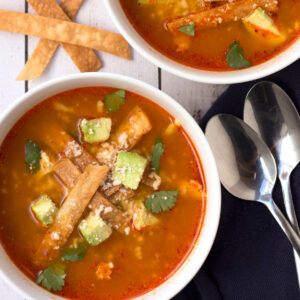 Bowl of Chicken Tortilla Soup with spoons