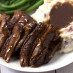 Plate of Pot Roast and green beans and mashed potatoes