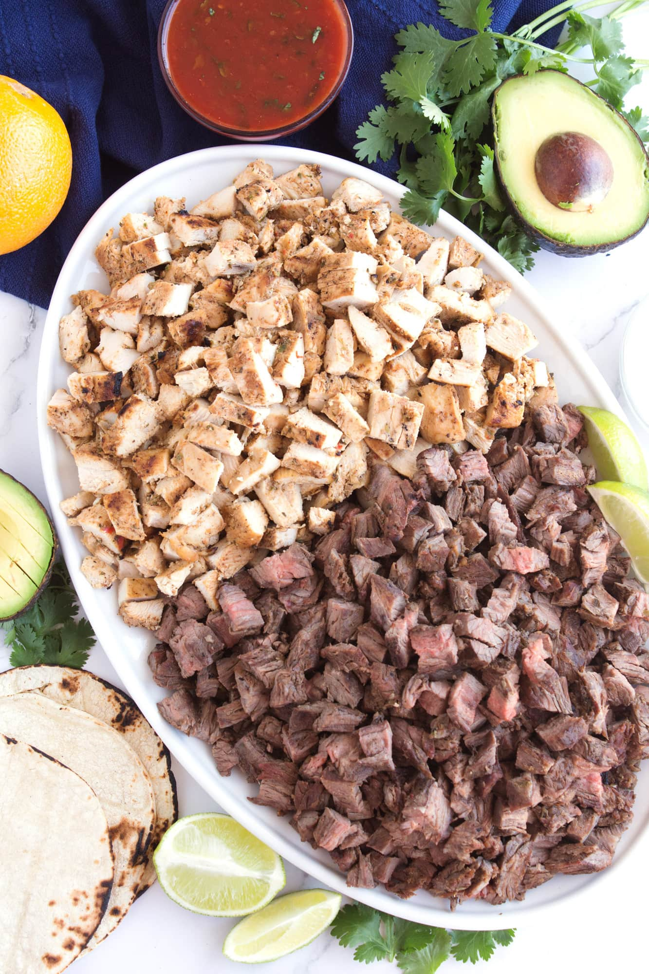 Grilled chicken and steak platter for tacos