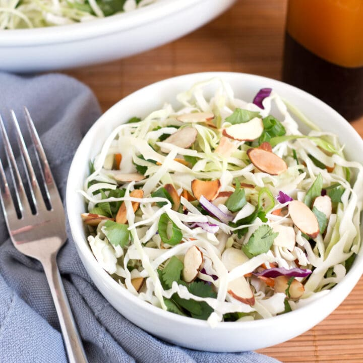 Bowl of Asian Slaw Salad with fork and blue towel