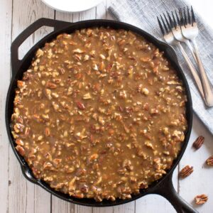Overhead of cast iron skillet cake with praline topping.