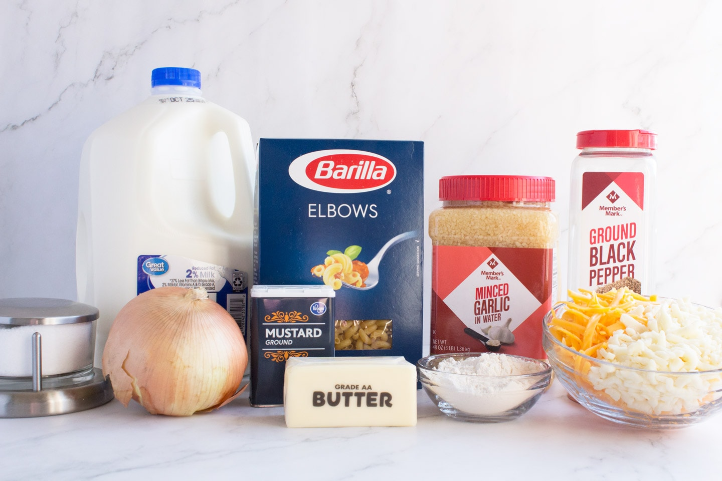Ingredients for mac and cheese on counter.