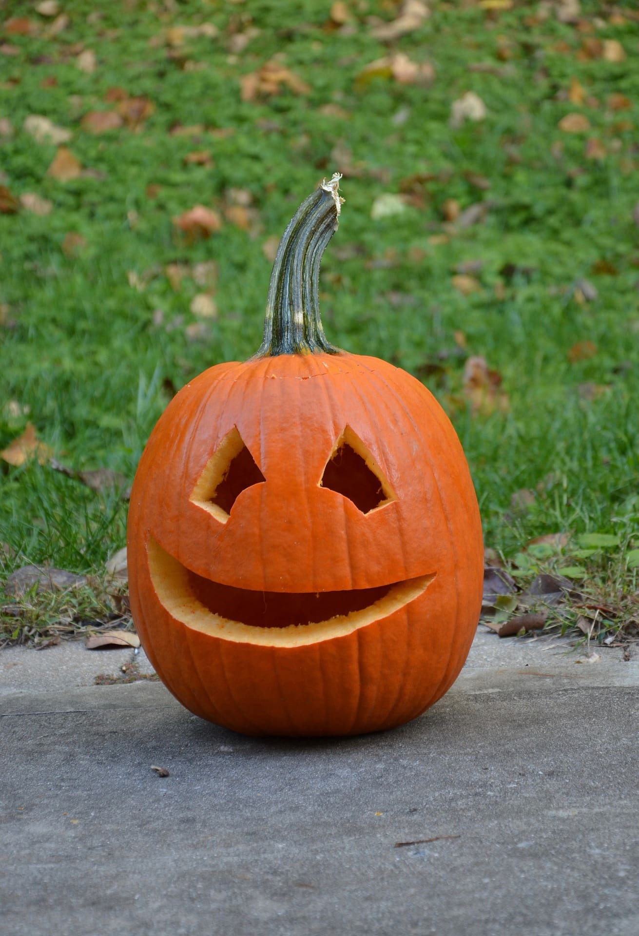 Carved pumpkin with a smiley face.