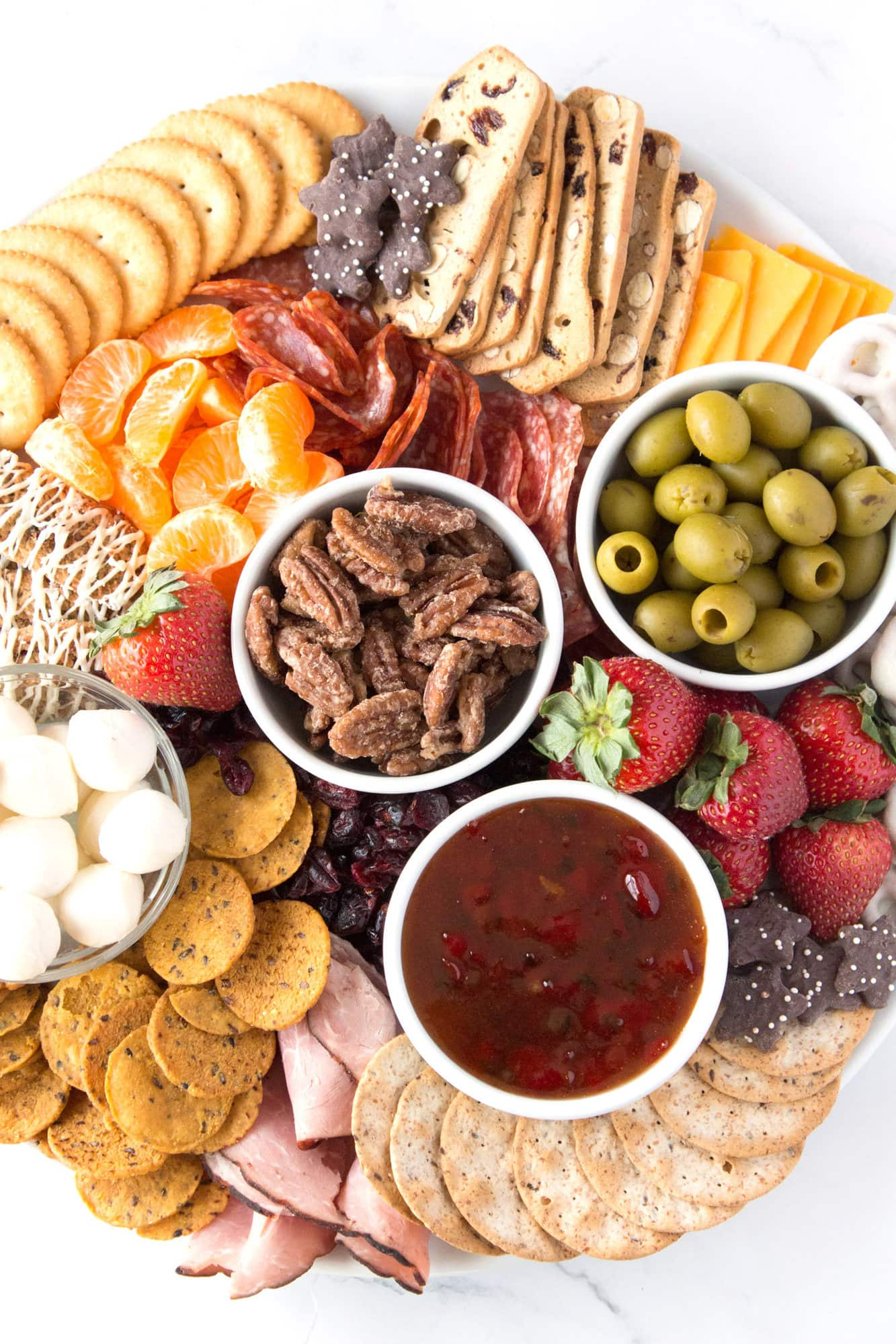 Overhead view of sweet and salty Christmas Snack Board on white platter