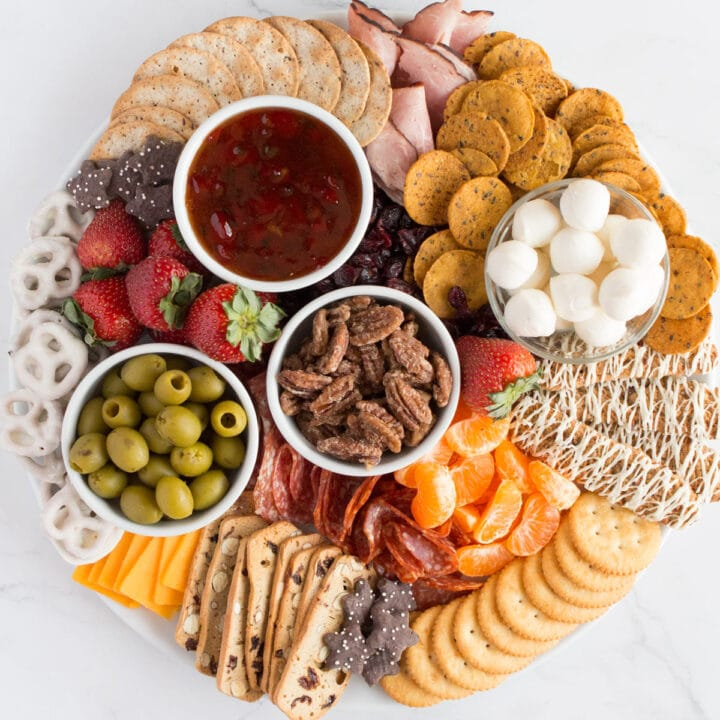 Full Sweet and Salty Snack Board with Christmas snacks.
