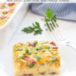 Picture of breakfast egg bake with bacon, green chilis, and cheese with graphic overlay.