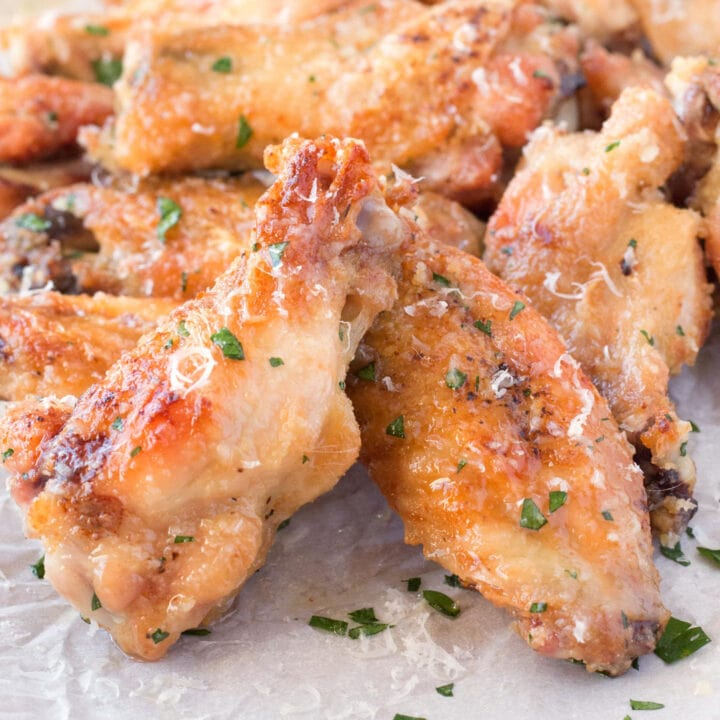 Close view of crispy oven baked chicken wings with garlic parmesan sauce